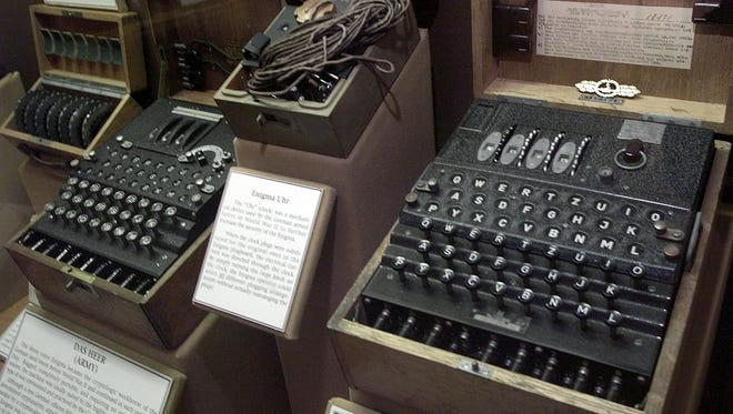 A four-rotor Enigma machine, right, was once used by the crews of German U-boats in World War II to send coded messages, which British World War II code-breaker mathematician Alan Turing was instrumental in breaking.