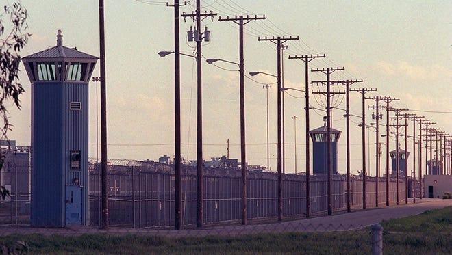 Guard towers line the perimeter of Corcoran State Prison in Corcoran, Calif.