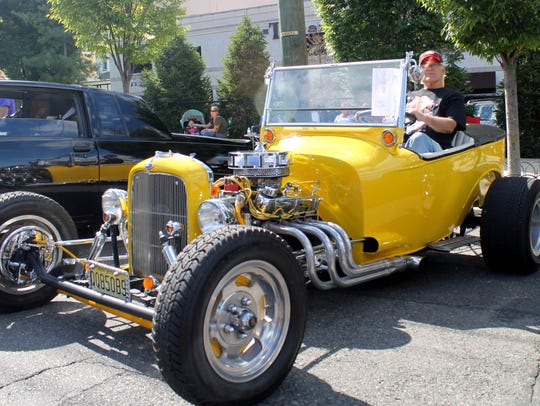 Luis A. Ruiz sits in his custom-restored 1927 Ford
