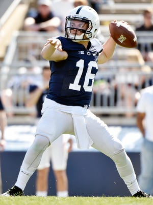 Penn State quarterback Billy Fessler throws during the Blue-White Game. Now he's the Lions' new holder on extra points and field goals.