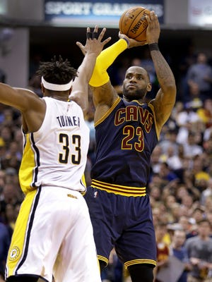 Cleveland Cavaliers forward LeBron James (23) puts up a three=pointer over Indiana Pacers center Myles Turner (33) in the second half of their NBA playoff basketball game Sunday, April 23, 2017, afternoon at Bankers Life Fieldhouse. The Pacers lost to the Cavaliers 106-102.