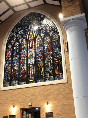 The large stained glass window in St. Paul's Episcopal Church is not yet repaired, but a digitized image of the original was made by a billboard company. This is how it looked on Sunday, April 1, 2018.