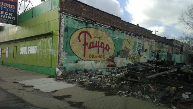 A Faygo advertisement seen on a building at Mt. Elliott Street and Georgia Street in January 2013 after a building was demolished next door.