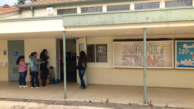 Students stand outside Summit School in Upper Ojai. The school board voted Wednesday to close the school due to declining enrollment. There will be no classes there for the 2018-19 school year.