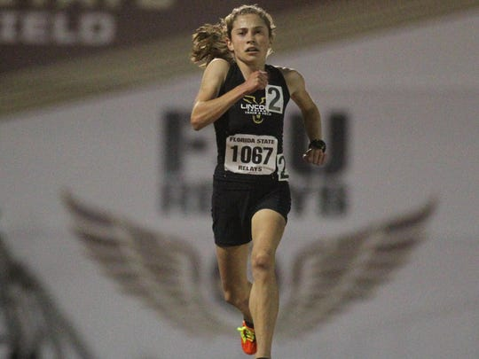 Lincoln freshman Alyson Churchill flies through the air during her 3200-meter run on Friday night at the FSU Relays. Churchill ran 10:23 to set a U.S. No. 1 time. She finished second in the 1600 on Saturday in 4:56.