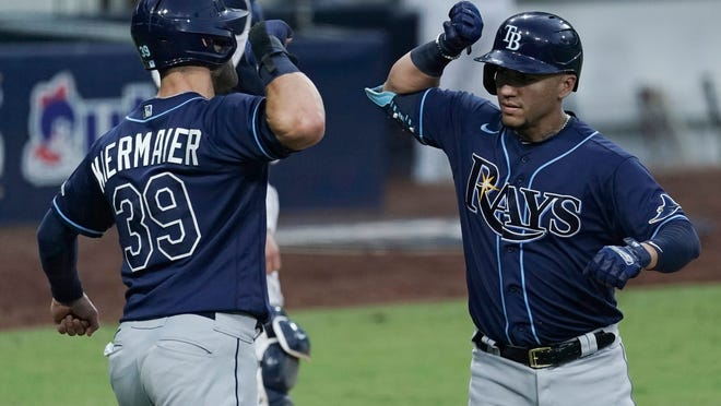 The Rays' Kevin Kiermaier, left, celebrates with Michael Perez after Perez hit a two-run homer to score Kiermaier against the Yankees during the sixth inning of Game 3 of the ALDS on Wednesday.