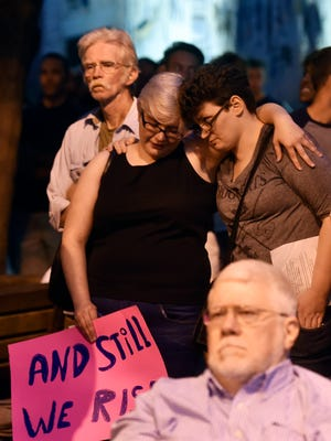 Hannah Phillips of Stewartstown and Sarah Liles of York lean on each other for support during the York Stands with Orlando; A Community Memorial Thursday, June 16, 2016, in Cherry Lane in York. The event, held several days after a gunman killed 49 people and injured 53 more at an Orlando, Fla., gay club in what became the worst mass shooting in modern American history, was attended by hundreds and featured speakers, performers and a candlelight vigil.