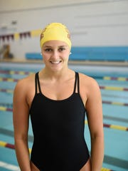 Katie Minnich has committed to swim at the University of Michigan. She will enter the state meet later this fall as the three-time defending 100 back state champion.