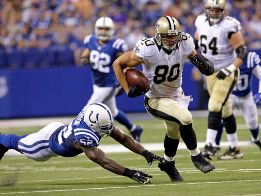 New Orleans Saints tight end Jimmy Graham (80) out runs the tackle of Indianapolis Colts inside linebacker D'Qwell Jackson during the first half of an NFL preseason football game in Indianapolis, Saturday, Aug. 23, 2014. (AP Photo/AJ Mast)