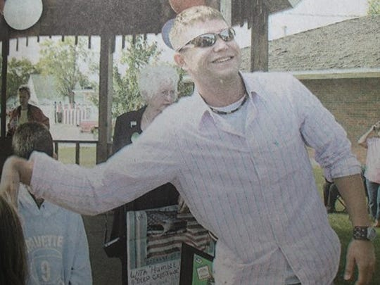 Uniontown native Jason Jackson flashed a big smile as he playfully shook hands with a small friend at the conclusion of a brief Welcome Home ceremony held for Jackson at the gazebo in downtown Uniontown on an October day in 2004.
