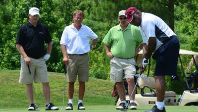 In this June 13, 2012 file photo, pro football Hall of Fame and University of Maryland Eastern Shore alumnus Art Shell putts while team members look on during the annual Art Shell Celebrity Golf Classic.