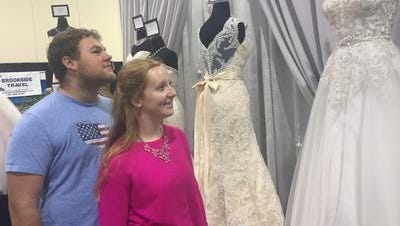 Matt Matteson, 25, of White Lake, and Kasey Buchholz, 23, of Lake Orion, look at bridal gowns at the Novi Bridal Expo in this 2016 file photo.