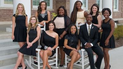 The Southern Miss 2014 Homecoming Court and Mr. and Miss Southern Miss include, standing left to right: Erin McLeod (Senior Maid), Emily Catherine Hope (Sophomore Maid), Kierra Garner (Queen), Rachael Holman (Graduate Maid), Madison Tynes (Freshman Maid), Eboni Thompson (Junior Maid); sitting, left to right: Jamie Jackson (Student Body Maid), Bethany Noelle Cuevas (Gulf Coast Maid), Shonice Musgrove (Miss Southern Miss), Wilton C. Jackson II (Mr. Southern Miss).