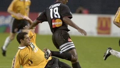 Former Rhinos midfielder/defender John Ball steals the ball from D.C. United's Carlos Llamosa in one of Rochester's past U.S. Open Cup matchups with the MLS squad.