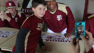 Jameis Winston (right) poses with Wyatt  Lansford at Fan Day in February before the start of the FSU baseball season.