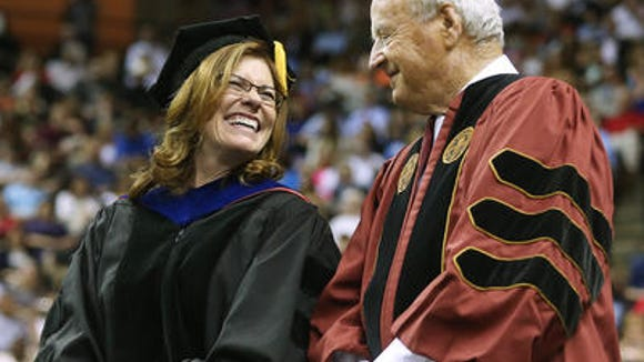 """Interim FSU President Stokes shares a laugh with football legend Bobby Bowden before presenting him with an honorary doctorate earlier this year. Asked about the role of athletics during her interview with the editorial board, Stokes talked about the athlete as a student, but also gave us a sincere """"Go Noles!"""""""