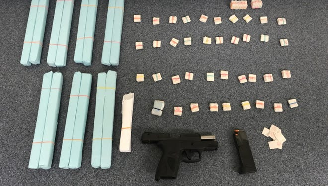 Drugs and a gun were found in the searches of homes in Selbyville and Frankford.