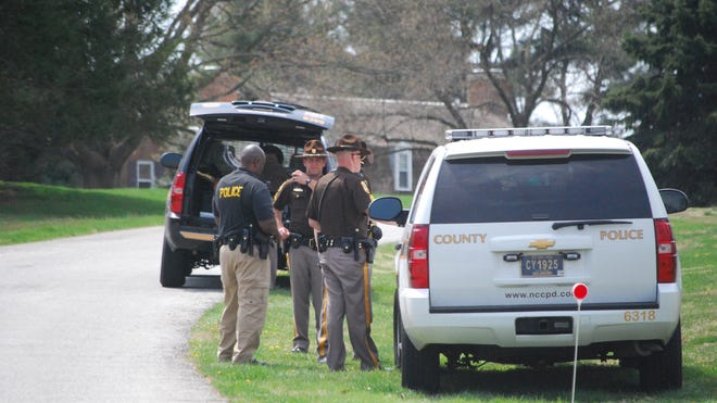New Castle County police investigate at home where body was found in driveway on High Ridge Road in Centreville.