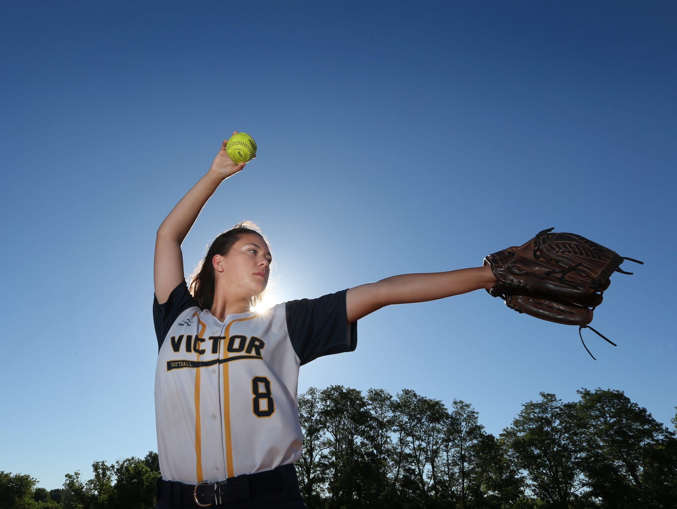 Victor's Katie Sidare on the mound at Victor High School