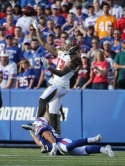 Tampa Bay's Mike Evans throws the ball back during