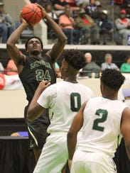 Lincoln's Dwight Wilson steps back for a shot during