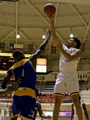 Midwestern State's Brandon Neel shoots over Texas A&M-Kingsville's