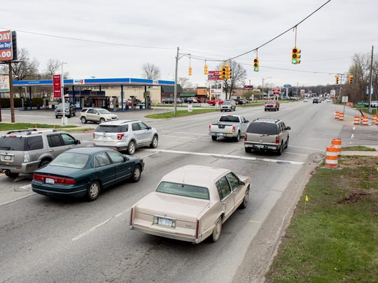 Vehicles travel through the intersection of 24th Avenue