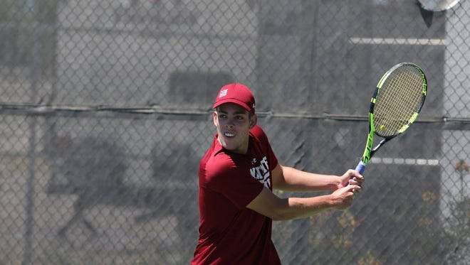 New Mexico State's Christofer Goncalves looks to return a shot in the Western Athletic Conference championship match on Sunday at the NMSU Tennis Center