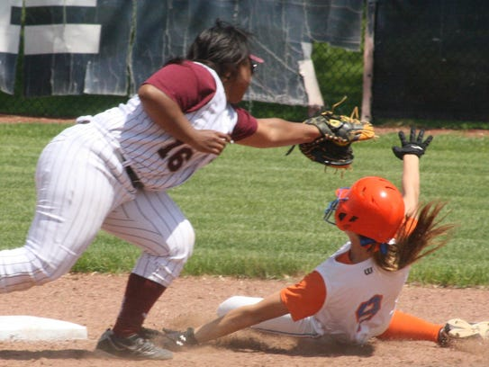Garden City's Mikey Smolar slides around a tag Saturday