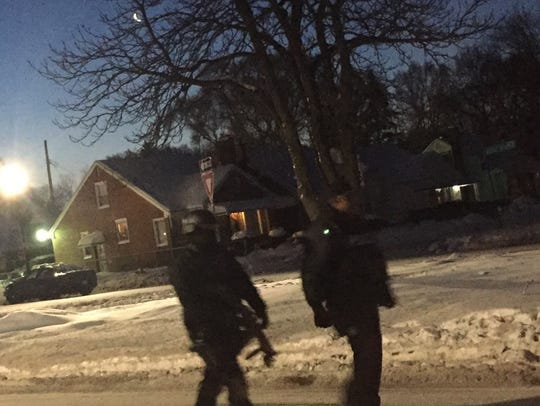 Police respond to a barricaded gunman situation Monday,