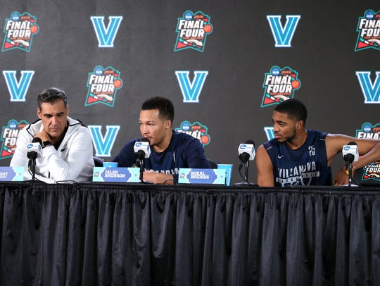 (From left) Villanova coach Jay Wright, guard Jalen Bruson and wing Mikal Bridges speak with members of the media Sunday at the Alamodome in San Antonio.