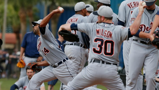 Detroit Tigers pitcher Alex Wilson (30) throws with others in the bullpen Monday, Feb. 23, 2015, in Lakeland, Fla.