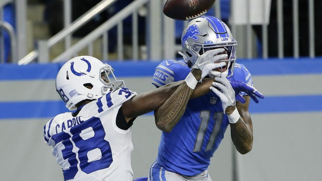 Indianapolis Colts cornerback T.J. Carrie (38) deflects a pass intended for Detroit Lions wide receiver Marvin Jones (11) during the second half of an NFL football game, Sunday, Nov. 1, 2020, in Detroit.