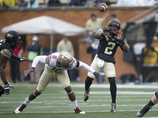 Wake Forest quarterback Kendall Hinton throws the ball