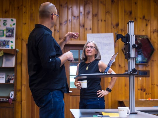 Marie Ambusk of HInesburg, co-founder of the start-up TREES ROI, a company that wants to help nurseries grow healthier trees, right, speaks with Wayne Maceyka of HinesburgHUBCoworking+ who organized a one-day co-working space at the Hinesburg United Church on Tuesday, July 25, 2017.