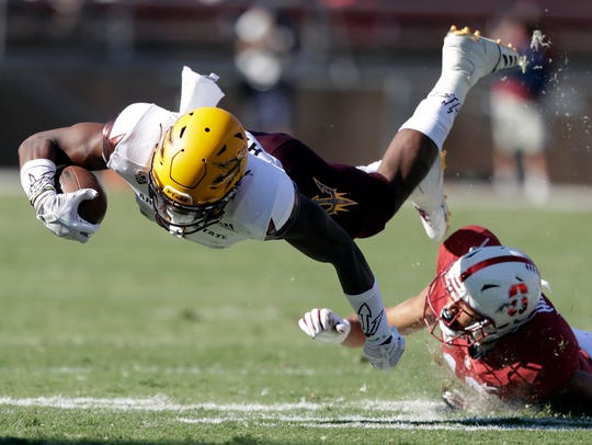 Arizona State wide receiver N'Keal Harry, left, is