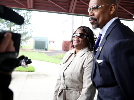 Rogers and her attorney, Clyde Bennett II, speak to