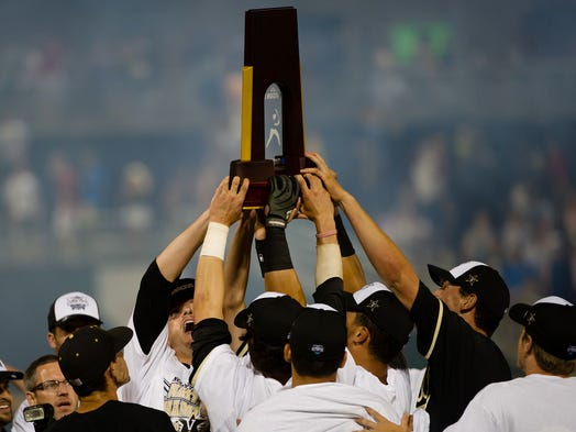 Game 3: Vanderbilt hoists the national championship trophy after beating Virginia 3-2 in the deciding game of the College World Series final.