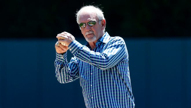 Former Tigers manager Jim Leyland throws out the ceremonial first pitch before the baseball game between the Tigers and Twins in Detroit, Saturday, May 10, 2014.