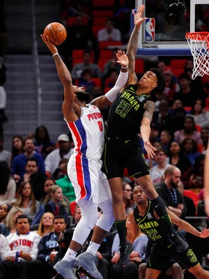 Pistons center Andre Drummond drives on Hawks forward John Collins on Wednesday at LCA.