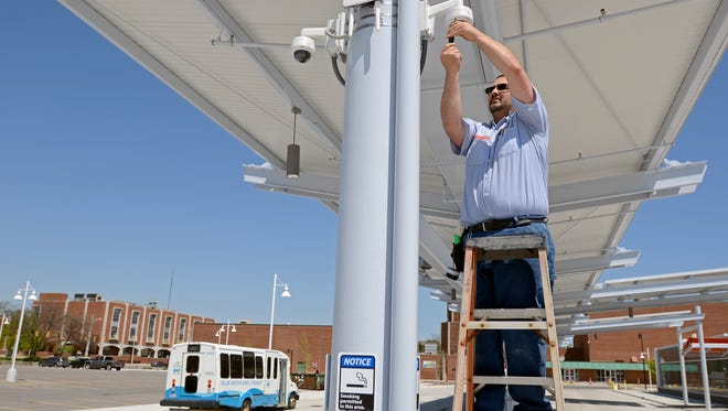 Garry Hunt, with Dyck Security, checks on some of the cameras Monday, May 23, at the Blue Water Transit Bus Center in Port Huron.