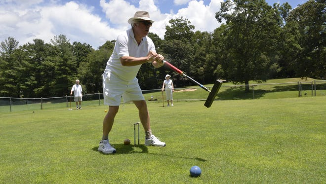 Jim Seward launches a ball toward his next wicket in a recent game of golf croquet at the Black Mountain Croquet Club
