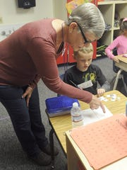 Foster Grandparent Joan Bagley works with a kindergartner at Yerington Elementary School.