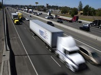 Senators offer bill to limit heavy truck speeds to 65 mph
