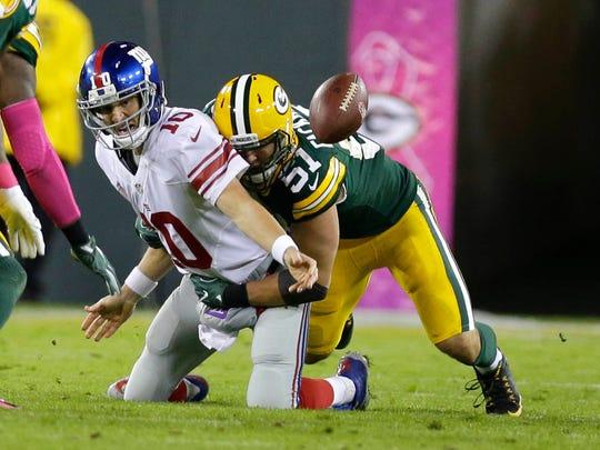 Packers outside linebacker Kyler Fackrell (51) sacks Giants quarterback Eli Manning during the first half on Oct. 9, 2016.
