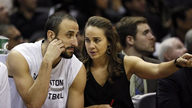 Becky Hammon, former CSU women?s basketball star and current  San Antonio Spurs assistant coach, talks with Manu Ginobili in this 2-14 file photo.