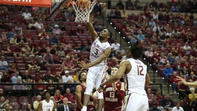 FSU's Trent Forrest dunks the ball against Boston College's during their game at the Tucker Civic Center on Saturday, March 3, 2018.