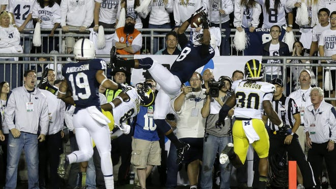 Penn State wide receiver Allen Robinson (8) catches a pass from Penn State quarterback Christian Hackenberg (14) over Michigan defensive back Channing Stribling (8) on Oct. 12, 2013.