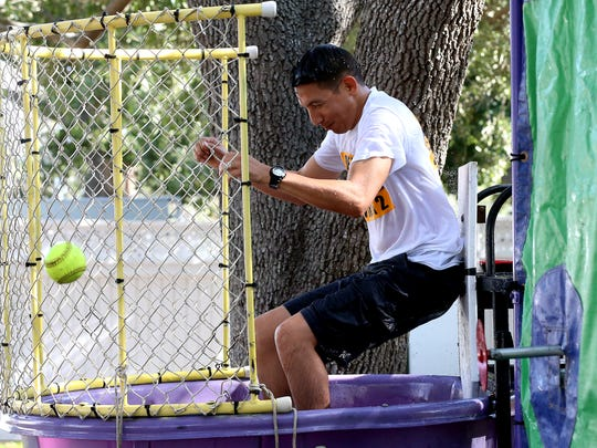 City Council Member Ben Molina gets knocked down in a dunk booth during the Get Your Play On Festival on Saturday, July 15, 2017, at Heritage Park in Corpus Christi.