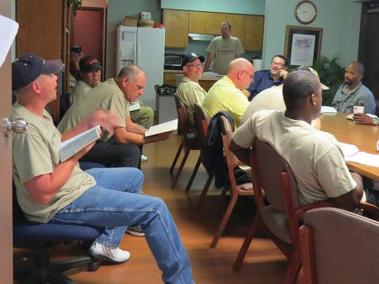 Bob Johnston meets with a group of men participating in the New Beginnings program at Faith Mission. His duties as director include teaching, counseling, preaching, work assignments, discipline, Bible studies and job and volunteer placement. He also works with jail and prison inmates to offer program options when they are released or paroled. Johnston said supervising between 16 and 20 men on any given day is not unlike raising a family with a lot of kids. The program, which has been running for 17 years, has been successful in getting people off the streets, back in the community and back in a family.